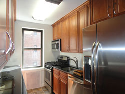 Scope Of Project The New Larger Kitchen Includes 42 Inch High Wall Cabinets  Stainless Steel Appliances